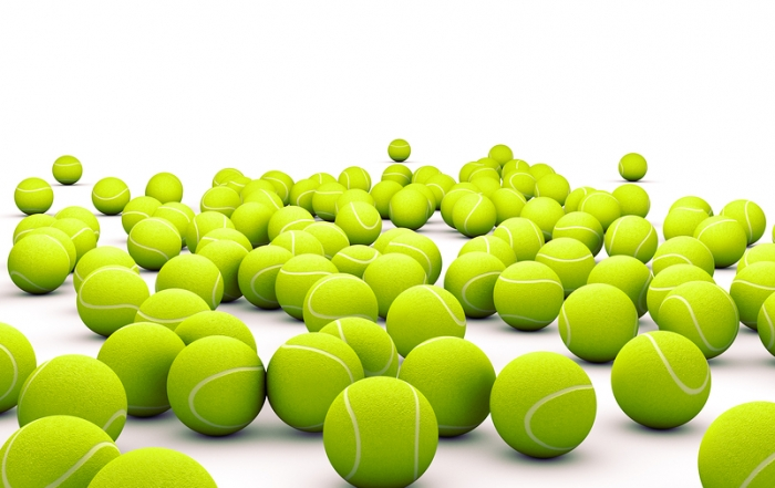 3d image of many tennis ball isolated on white